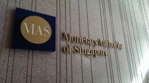 MAS lifts dividend cap on local banks, financial companies